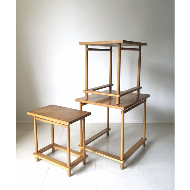 A set of three nesting tables designed by T.H Robsjohn Gibbings and produced by Widdicomb. This set has the original...