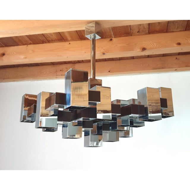 Large Mid-Century Modern chrome 12 lights cubic chandelier, by Gaetanao Sciolari, Italy 1960s Square shape. Rewired for...