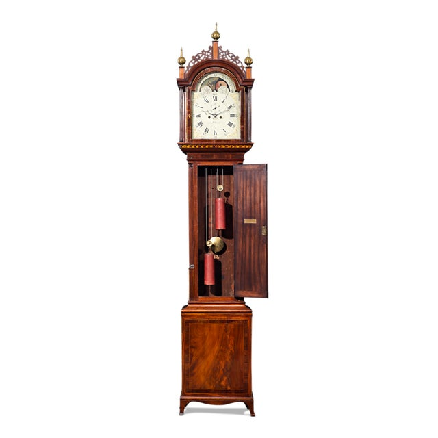 This exceptionally rare and enchanting grandfather clock is a remarkable treasure of American craftsmanship. Superiorly...