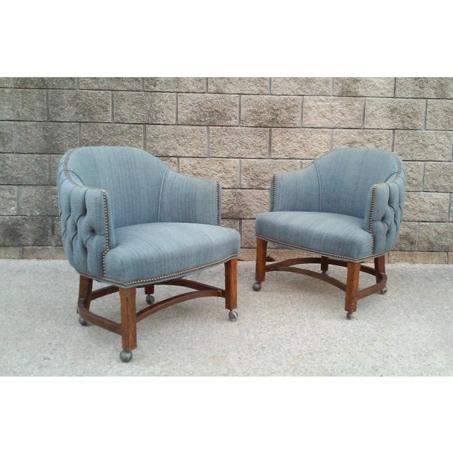 An amazing pair of tufted chairs with barrel backs and nail head trim on casters. These chairs are suitable for guest...