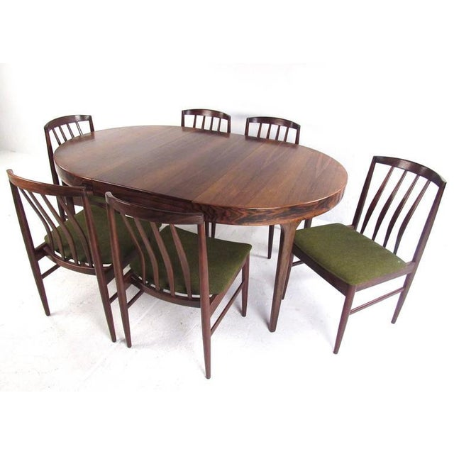 This stunning vintage dining set features six sculpted rosewood chairs by Vamo Sonderborg and circular Ib Kofod-Larsen...