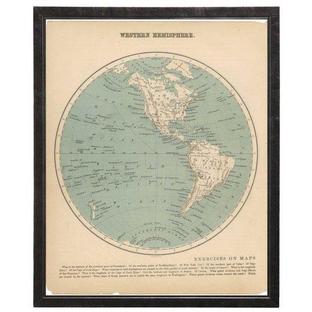 A Western hemisphere map framed in a pewter shadowbox. 17.5x21.5