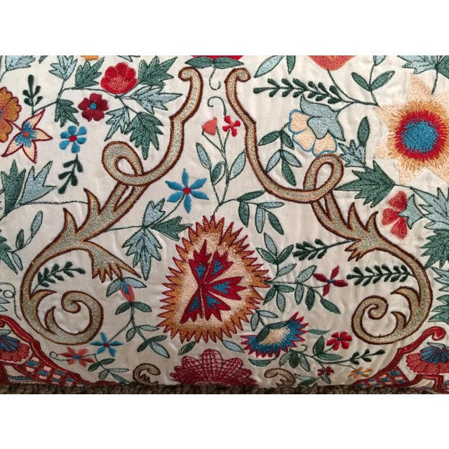 This elegant accent pillow has been meticulously embroidered with multi colored silk and metallic threads on hand woven...