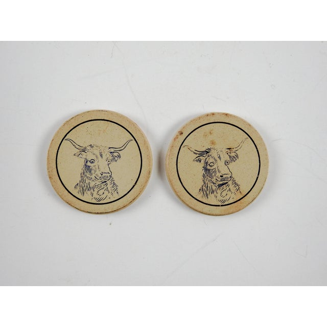Set of 2 antique clay (composition type) circa 1900 poker chips. Cream with blue engraved head of a steer or cow, overall...