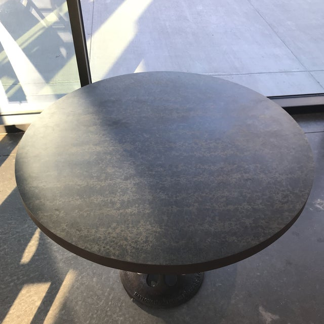 """Unique Galvanized 36"""" round metal table with found iron base. Base is marked National Ideal Score Board. Makers expose..."""