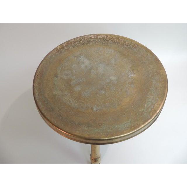 Vintage Round Indian Brass Milking Stool Vintage round Indian brass etched top stool with three legs that screw to under...