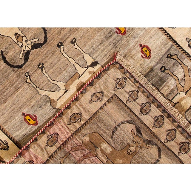 Vintage hand-knotted Gabbeh rug with a animal motif. This piece has magnificent detailing and great colors. It would be...