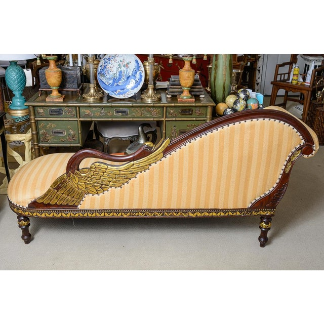 Great Hollywood Regency Hand Carved wood Swan Recamier or Meridienne. to my knowledge the wood is Mahogany. Gold accents...
