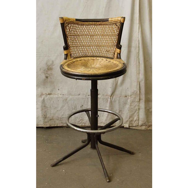 Light & dark wicker tone mix with black and chrome colored base. Oriental style.