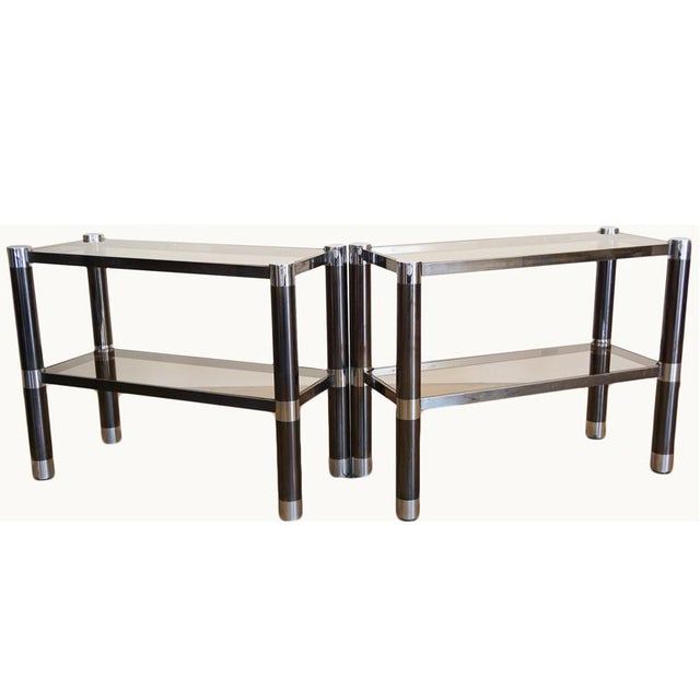 Gunmetal Finish Over Solid Brass Rails, With Chrome Attachments Caps. Smoked Glass Shelving. Adjustable feet.