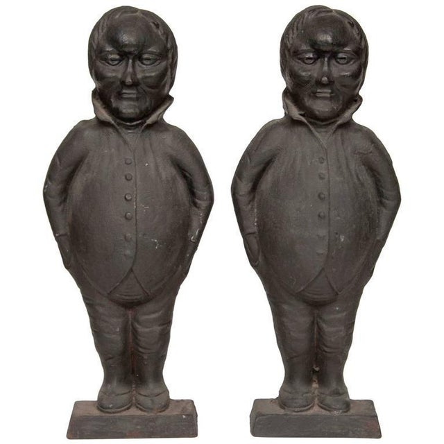 A wonderful pair of American cast iron andirons in the form of Tweedledee and Tweedledum.