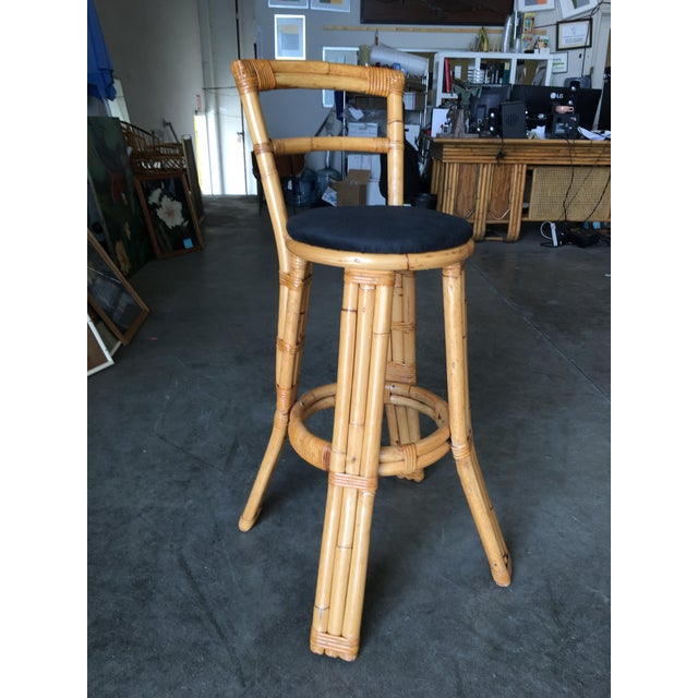 Set of two rattan bar stools with black cotton seats and three strand rattan pull legs. Each stool comes with a full...