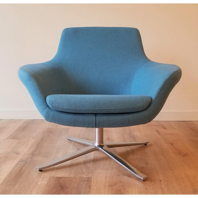 This Bob Lounge swivel chair was designed by Pearson Llyod for Steelcase. It has been recently upholstered in a light blue...
