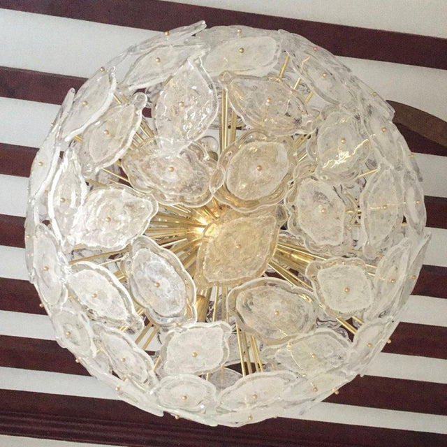 A very elegant Sputnik chandelier, entirely handmade in Italy with a Mid-Century Modern flair. The round design shows...
