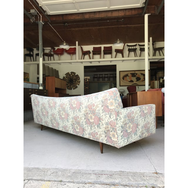 Curved front sofa with walnut legs. In amazing pristine condition! Was reupholstered years ago and never used. Often...