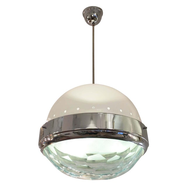 Large pendant attributed to Lumi featuring a faceted glass lens on a chrome frame. There is a second glass lens inside the...