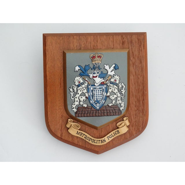 Circa 1950, an English Metropolitan Police, United Kingdom crested wall plaque. The coat of arms is slightly raised in a...