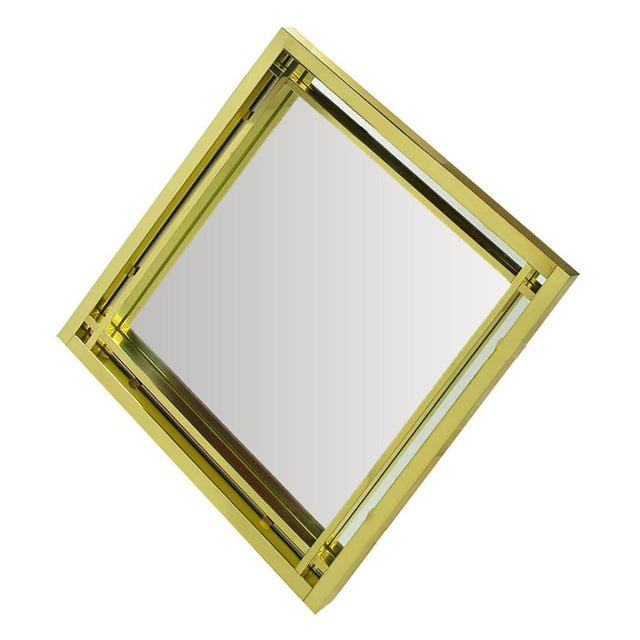 Elegant modern diamond shaped double framed mirror with open crossed corners in the style of Pierre Cardin. Excellent...