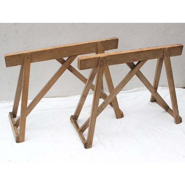 Antique wood saw horse table bases. Made in the late 19th century.