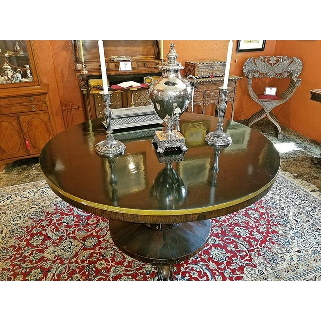 REALLY NICE early 19th Century Regency period large tilt-top center or breakfast table. The top has been ebonized and the...