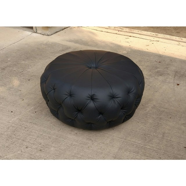 We love a Moroccan pouf, but update it in a buttery, solid navy cowhide leather and add some deep tufting on the sides,...