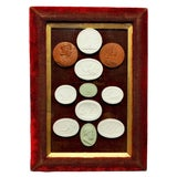 Image of Early 19th Century Arrangement of Grand Tour Plaster Cameos in Velvet Frame For Sale