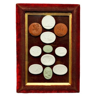 Early 19th Century Arrangement of Grand Tour Plaster Cameos in Velvet Frame For Sale