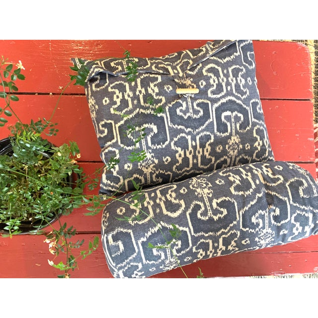 Set of two navy & beige Ikat fabric pillows. One bolster and one rectangular envelope pillow with a tab & button closure....