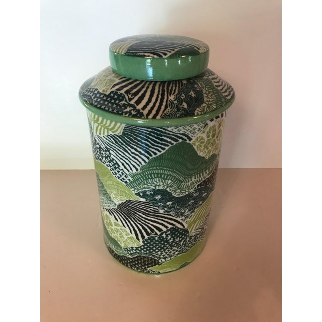 A Madcap Cottage green/blue lidded porcelain jar from Port 68, inspired by the Madcap's Windsor Park fabric. The lid lifts...
