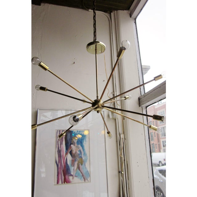 This is a vintage Mid-Century modern brass atomic era sputnik chandelier with 12 arms. It is a perfect dining room or...