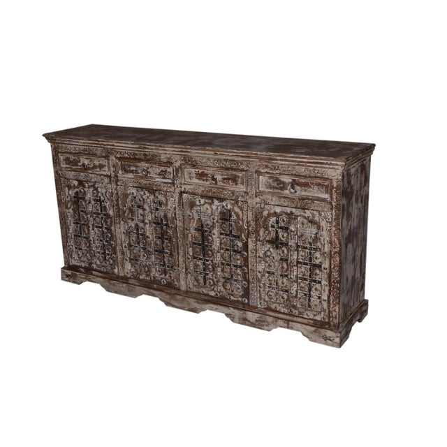 Organize all your dining essentials with this rustic sideboard. This rustic style sideboard features a wide tabletop,...