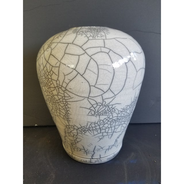 Market found, I love the white and charcoal naturally organic feel of this glazed Raku pottery vase by Les Mitchell,...