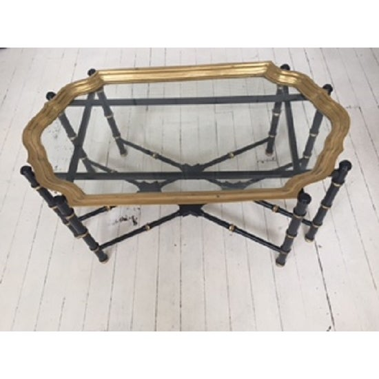 Attractive Hollywood Regency glass & brass (unlacquered) coffee table. Rests on a faux bamboo wood turned base finished in...