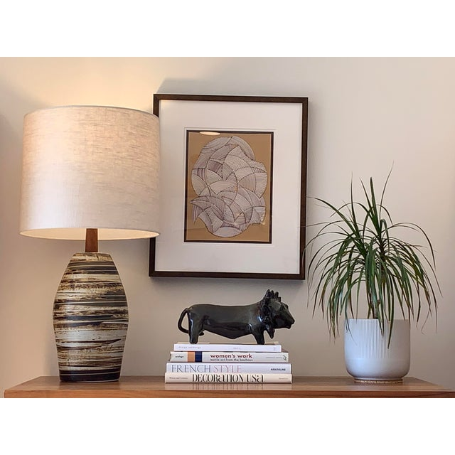 Mid-century modern lamp from Jane and Gordon Martz for Marshall Studios featuring a large ceramic base with an earthy...