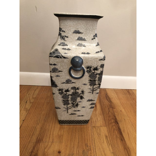 Ceramic vase with beautiful Asian inspired paintings. The colors are soft blues, great bone and white. Has a padded base.