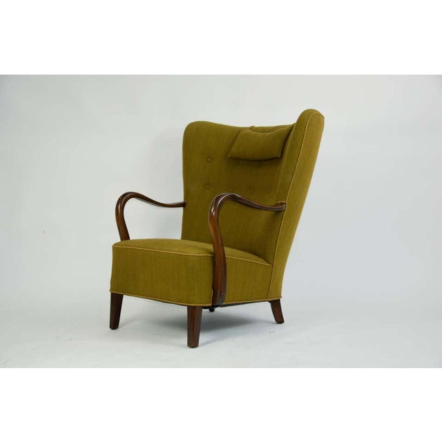1940s Danish lounge chair by Alfred Christensen. Sculpted Beech wood frame refinished. Original Upholstery