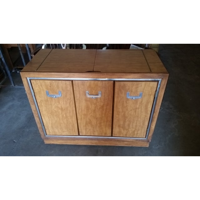 Mid century modern Server Credenza. This vintage mid century buffet server has caster wheels for easy mobility. There are...