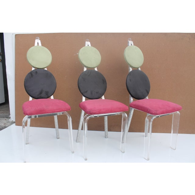 Vintage lucite and art aluminum polished dining chairs with lucite decorative ball at the end of the seat back. These...