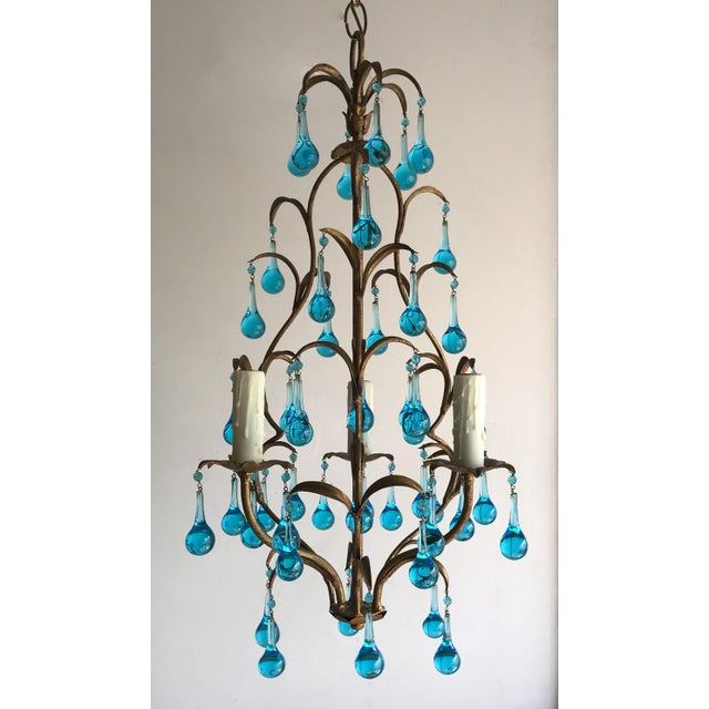 Beautiful, 1950s Italian gilt-iron chandelier with aqua-blue Murano drops in the Provincial style. The chandelier consists...