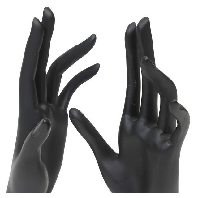 Great pair of black painted cast resin mannequin hands with elongated fingers.