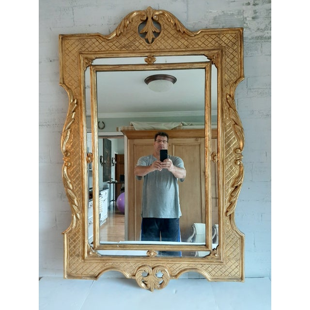 """Vintage Italian gilt wood mirror. Stunning """"quilted"""" border. Double edge mirror with foliate center carved mounts and edging."""