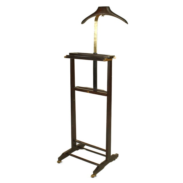 Italian 1940s mahogany stained and brass valet stand with an adjustable coat hanger and accessories shelf on casters...