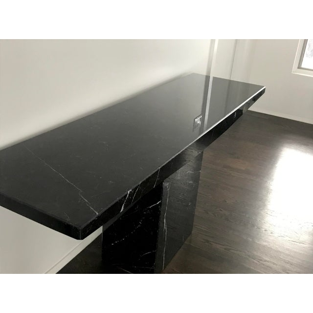 Stunning and rare Stone International for Ello black marble pedestal console table. The marble surface is absolutely...