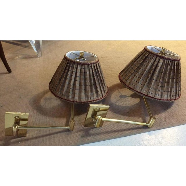 Pair of double swing arm wall lamps designed in 1947 by George W. Hansen for Hansen Lamps New York. Manufactured by...