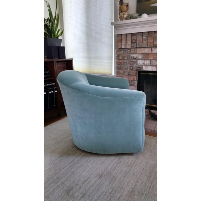 A brand new upholstered swivel & rocker barrel chair. Acqua color poly/cotton velvet upholstery. Made by Bella Furniture....