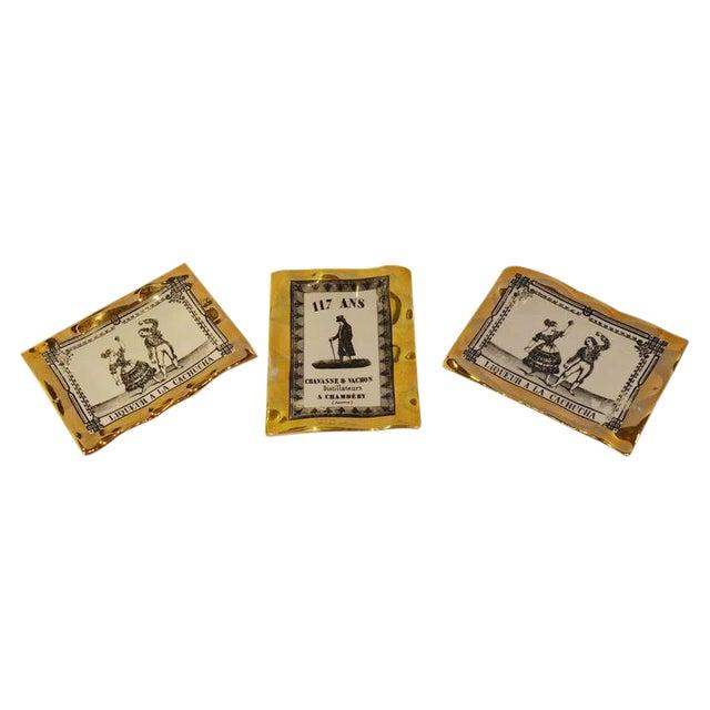 Fornasetti Italian Advertising Label Set of Three Porcelain Pin Trays - Image 1 of 1