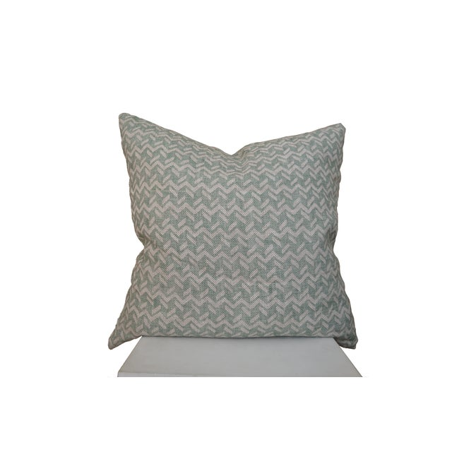 """This custom 20""""x20"""" pillow features Fermoie's Chiltern fabric in a pale green, with a subtle geometric print on 100% linen..."""