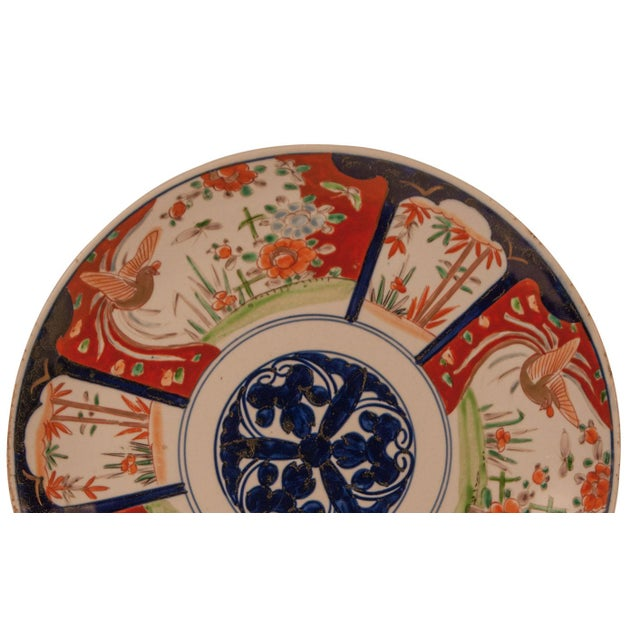 A late 19th Century Japanese Imari charger with three flowers in the center
