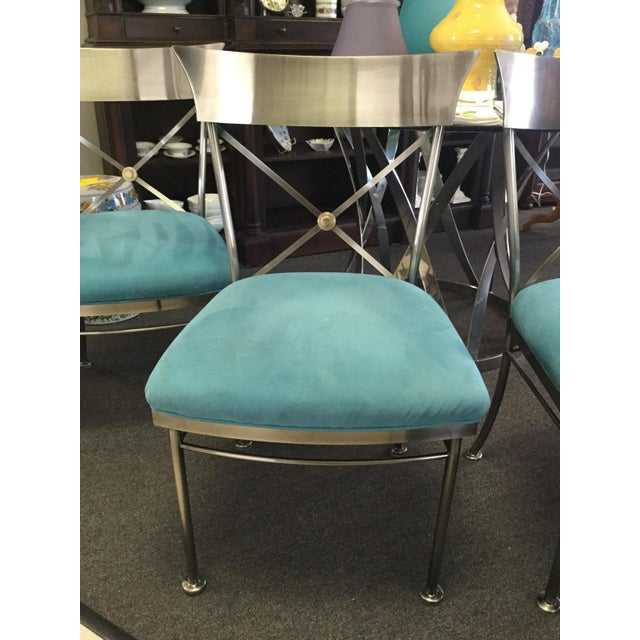 Set of 4 mid century modern dining/side chairs. Price includes all 4 chairs as shown. Turquoise blue sueded upholstery on...