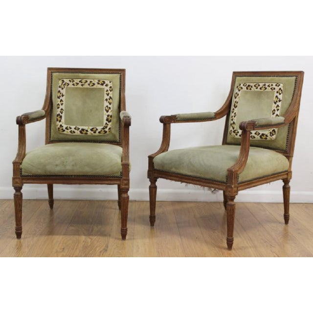 Pair, French Louis XVI style armchairs, from the early 20th century. Minor repairs Upholstery on arm rests is worn, a few...